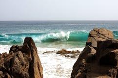 Wave and rock Stock Photos