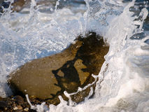 Wave and rock on the sea. Water wave and rock in the sea Royalty Free Stock Image