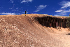 Wave Rock, Western Australia. A photographer stand up the Wave Rock, Hyden, Western Australia royalty free stock photos