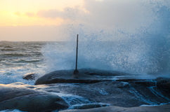 Wave on rocks Stock Photography