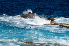 A wave and rocks at Malta near Cirkewwa Ferry Terminal. Royalty Free Stock Photo