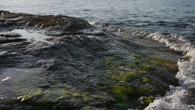 Wave on the rocks stock video footage