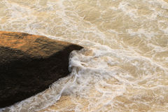 Wave on the rocky  and beach Royalty Free Stock Photography