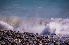 Wave on the rocky beach Royalty Free Stock Images