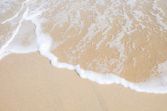 Wave roll into beach. With white clean foam Royalty Free Stock Photography