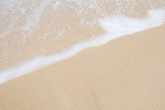 Wave roll into beach. With white clean foam Royalty Free Stock Images