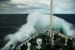 Wave rolling over the snout of the ship Royalty Free Stock Images