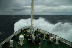 Wave rolling over the snout of the ship Royalty Free Stock Photo