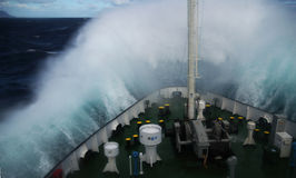 Wave rolling over the  snout of the ship Stock Images