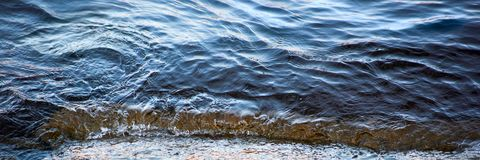 The wave rolls ashore is close. Up stock images