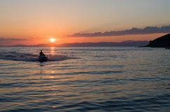Wave runner. Water sports jet sky on a sunset Royalty Free Stock Photography