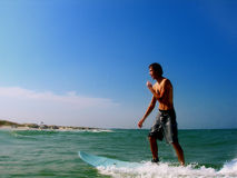 Wave Running. A Florida teenager surfing Stock Images