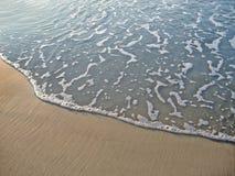 Wave on sand. Sea wave on sand background Stock Photos