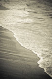 Wave and sand. Mediterranean Sea coast in the evening Royalty Free Stock Photos