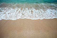 Wave and sand Stock Photography
