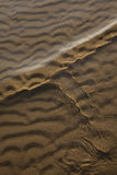 Wave and sand. Summer, beach, sand and the wave are the protagonists Royalty Free Stock Image
