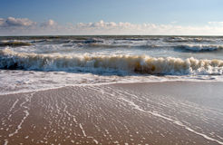 Wave and sand Stock Image
