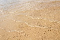 Wave on the sand Royalty Free Stock Photo