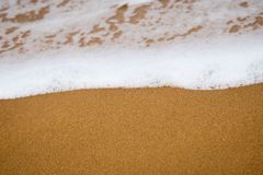 Wave on the sand beach royalty free stock photos