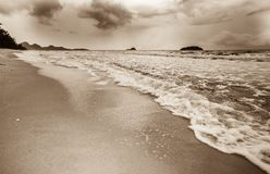 Wave on the sand beach Sepia tone Stock Images