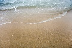 Wave on the sand beach royalty free stock photo