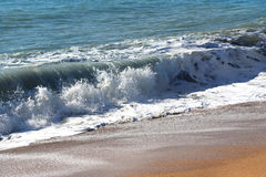 Wave on the sand beach. Waves in the sea and sand on the beach Stock Photography