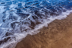 Wave on the sand Stock Photo