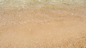 Wave and sand gloden beach in sunny day cha-am thailand stock video