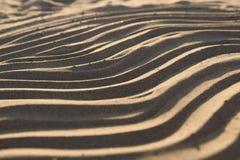 Wave on sand Stock Photos