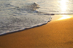 Wave on sandy beach Stock Photo
