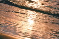 Wave of a sandy beach and glare of sun, pink background, texture. Wave of a sandy beach and glare of the sun, pink background, texture stock images