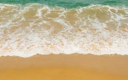 Wave on a sandy beach stock photos