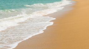 Wave on a sandy beach stock images