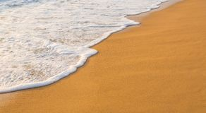 Wave on a sandy beach royalty free stock images