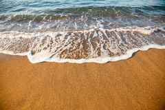Wave on sandy beach Royalty Free Stock Photography