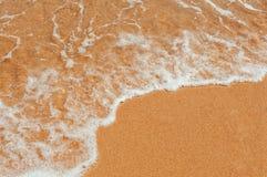 Wave on a sandy seashore Royalty Free Stock Photos