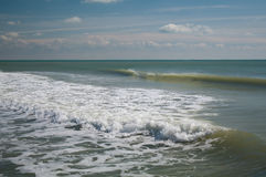 Wave in the sea. Low wave in the sea during inflow Stock Photos