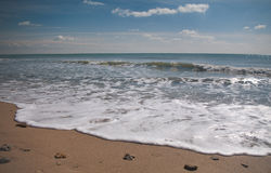Wave in the sea. Low wave in the sea during inflow Stock Photo
