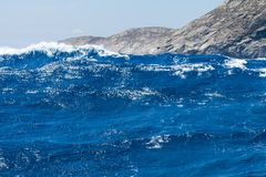 Sailing yacht on the sea. The wave in the sea, blue water, strong waves Stock Photography