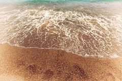 Wave sea and rocks on beach Stock Photos