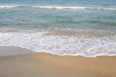 Wave of the sea on sand beach Stock Photography