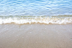 Wave of the sea on the sand beach Royalty Free Stock Image