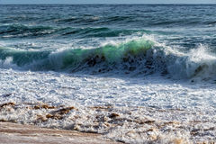 Wave of the Sea on the Sand Beach Stock Photo