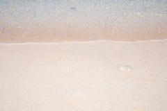 Wave of the sea on the sand beach Stock Photos