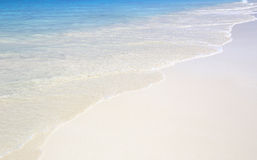 Wave of the sea on the sand beach Royalty Free Stock Photo