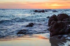 Wave of the sea on the sand beach. Seashore on sunset Stock Image