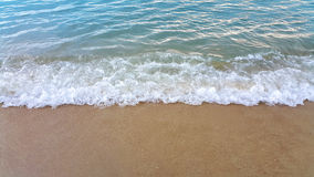 Wave of the sea on the sand beach Stock Image