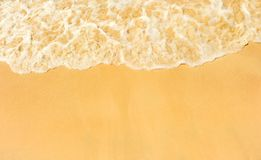 Wave of the sea on the sand beach Royalty Free Stock Images