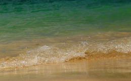 Wave of the sea on sandy beach Royalty Free Stock Photos