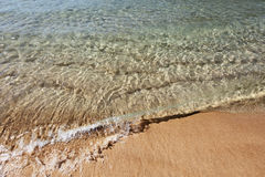 Wave of sea on sandy beach Royalty Free Stock Image